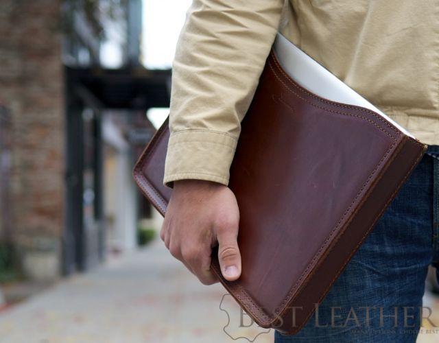 Holding Saddleback Leather MacBook Pro Sleeve in Chestnut