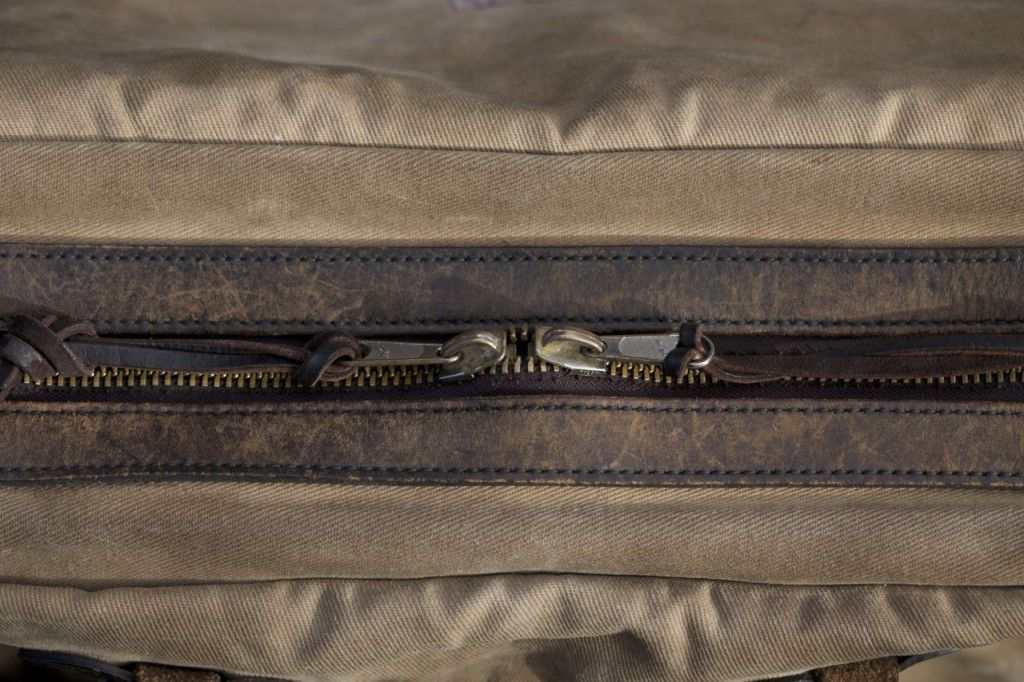 The YKK zipper is covered by a flap of oiled canvas for good security and water protection.