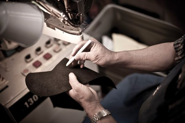 Real people with real hands constructing boots by hand. That is what I like to see. Courtesy of Danner Boots.